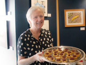 Woman with a tray of tasty-looking hors d'oeuvres