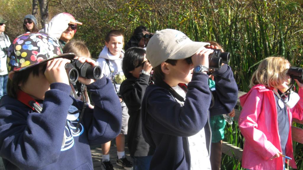 Students with binoculars