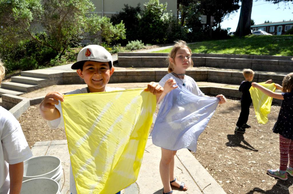 Children doing activities in the museum amphitheater