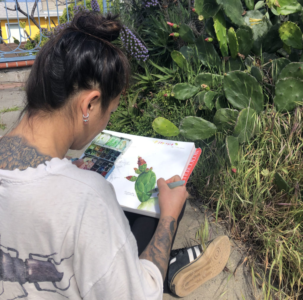 Yvonne Byers painting a watercolor of a cactus