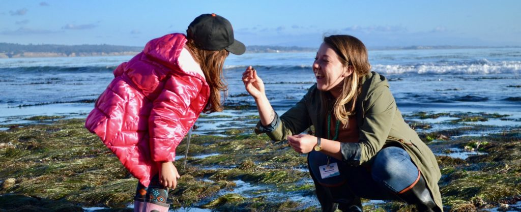 Marisa beachcombing with a young student