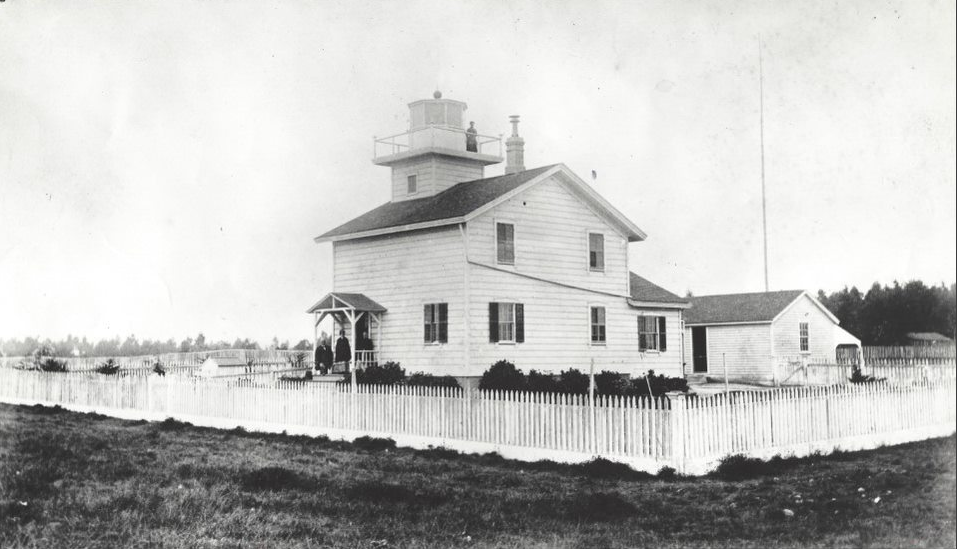 Black and white photograph of the Hecox family standing in front of the Santa Cruz Lighthouse.