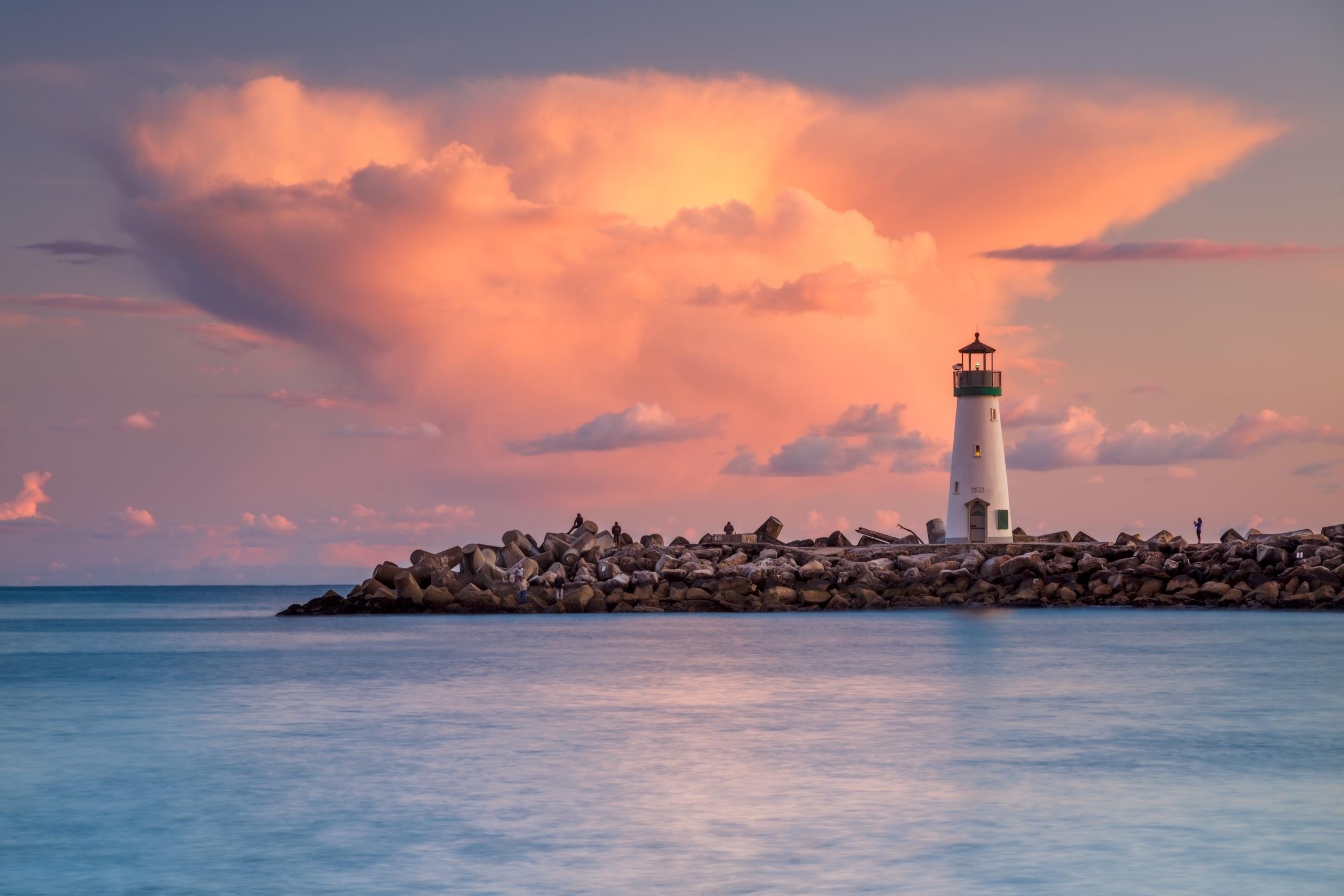 Pink clouds backdrop the Walton Lighthouse at the Santa Cruz Harbor.