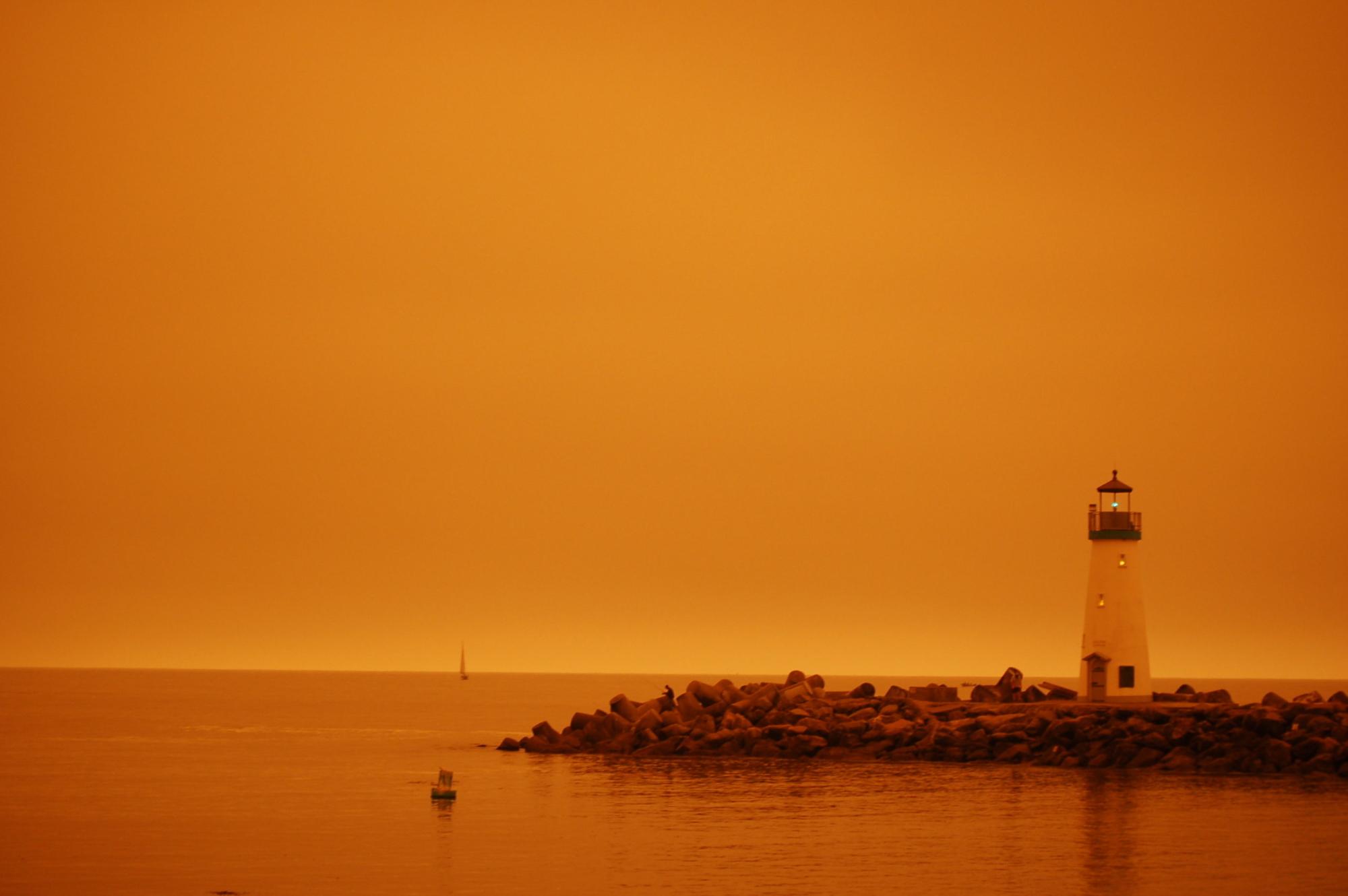The Walton Lighthouse under an orange glow.