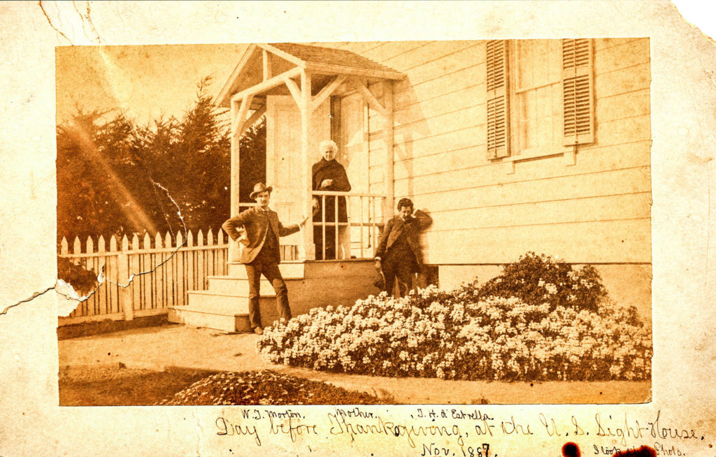 Historic image of 3 people on the steps of the Santa Cruz Lighthouse.