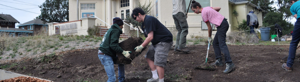 Students performing landscaping outside the museum