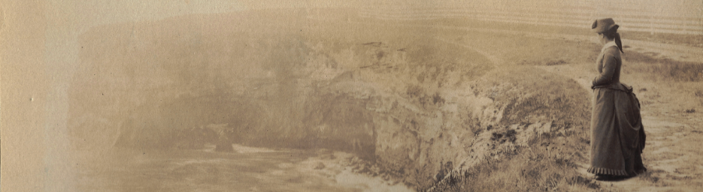 historic photograph of Laura Hecox standing along the coast